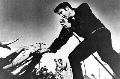 elvis singing to a crowd of admirers