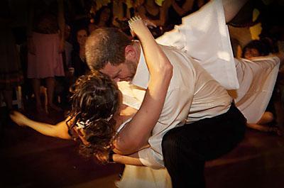 Man dipping woman at wedding dance